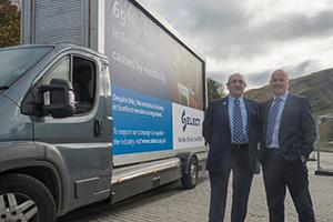 SELECT's campaign to Regulate Electricians on the side of a grey van